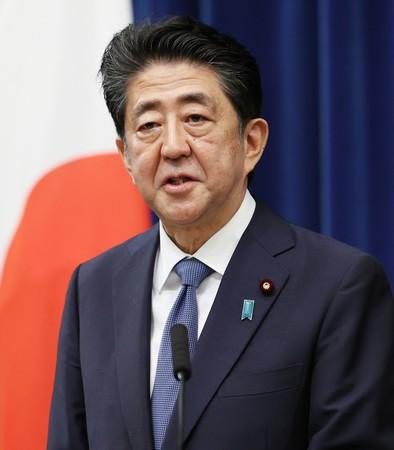 辞任 表明 首相 安倍