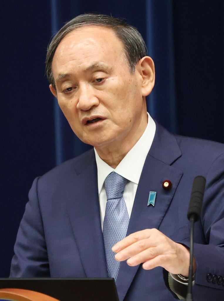 記者会見する菅義偉首相=30日午後、首相官邸